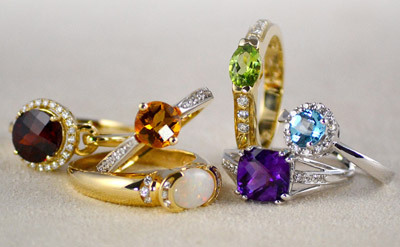 A selection of beautiful diamond rings cut from various precious gemstones.