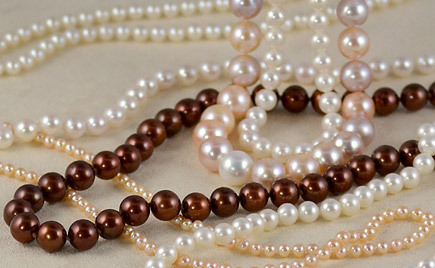 Pearl necklaces in many subtle hues and variations.