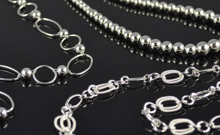 Necklaces and bracelets crafted from silver.